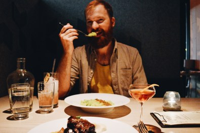 Daan enjoying his vegetarian dish at Juniper restaurant | Gay-friendly Restaurants Vancouver © Coupleofmen.com