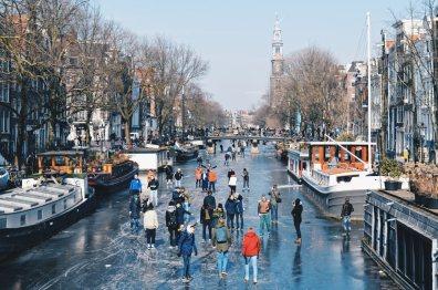 House-Boat Hotel and Westertoren   Amsterdam Frozen Canals © Coupleofmen.com