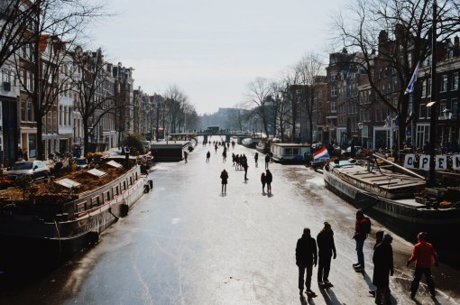 Winter on Amsterdam's frozen canals Ice-Skaters on Prinsengracht | Amsterdam Frozen Canals © Coupleofmen.com