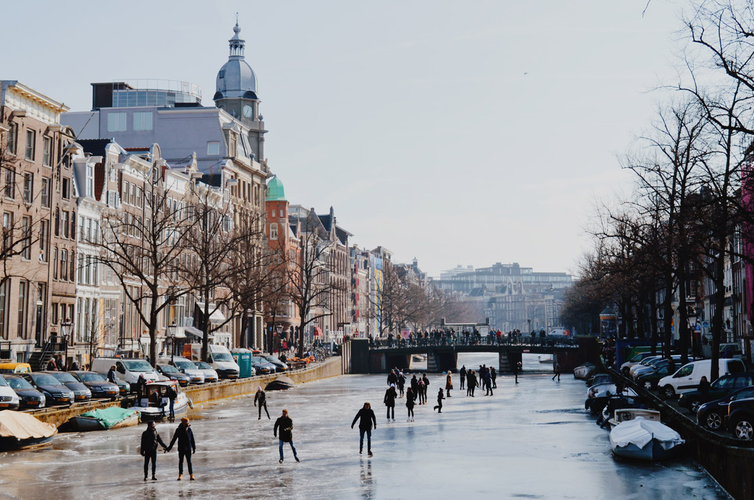 Winter on Amsterdam's Frozen Canals Ice Skaters on the Keizersgracht   Amsterdam Frozen Canals © Coupleofmen.com