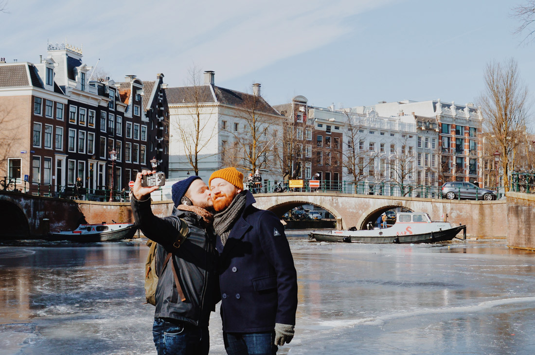 Winter on Amsterdam's Frozen Canals A Gay Kiss Selfie on the ice of the Keizersgracht   Amsterdam Frozen Canals © Coupleofmen.com