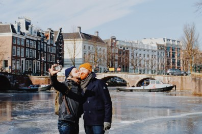 A Gay Kiss Selfie on the ice of the Keizersgracht | Amsterdam Frozen Canals © Coupleofmen.com