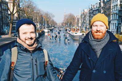 Winter on Amsterdam's frozen canals Hand-in-hand with frozen canals as a backdrop | Amsterdam Frozen Canals © Coupleofmen.com