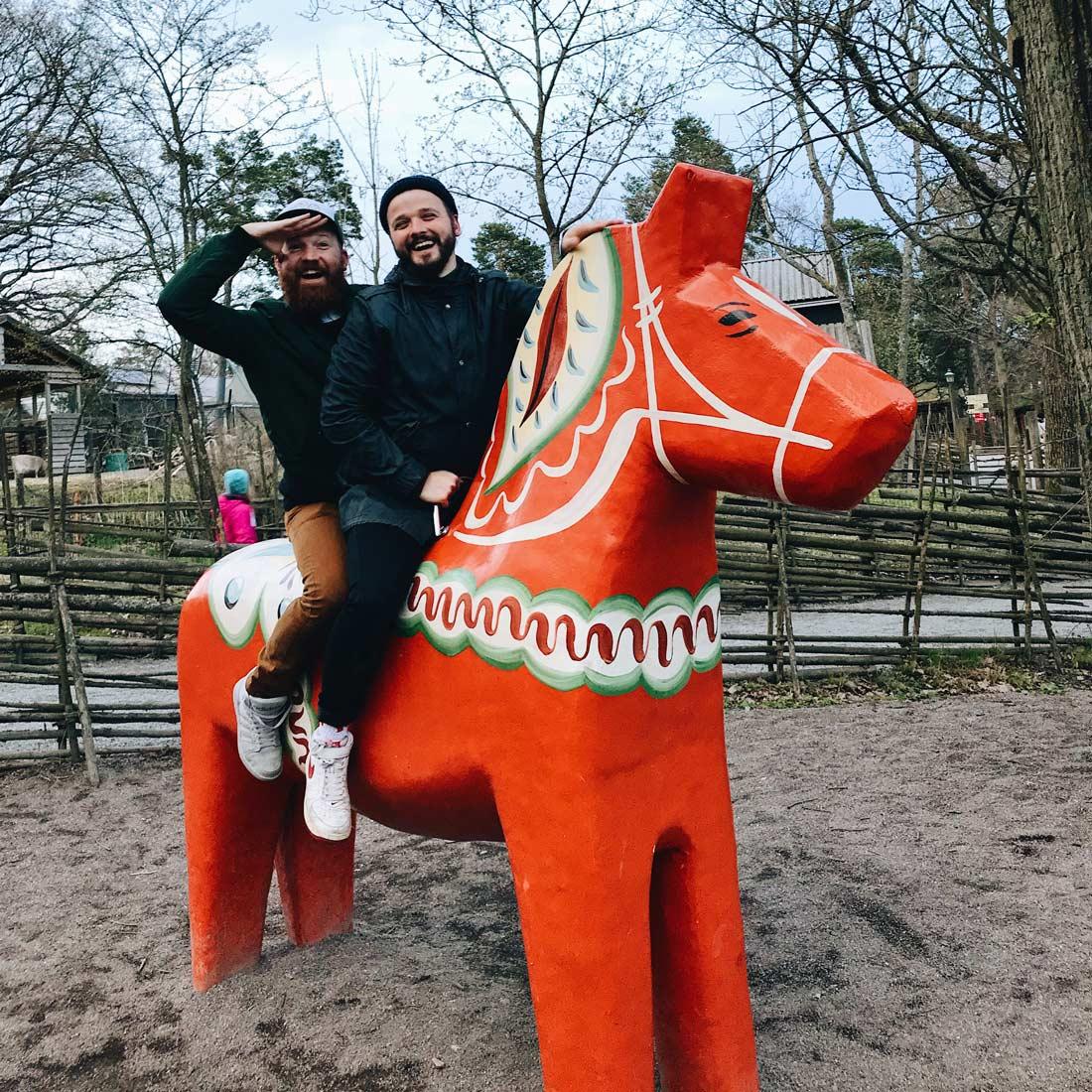 Riding a Dalecarlian or Dala horse at open-air museum Skansen   Gay Travel Tips for EuroPride 2018 Stockholm © Coupleofmen.com