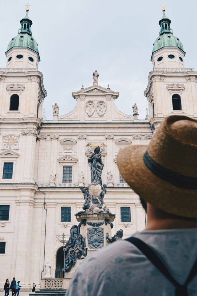 Gay Städtetrip Salzburg Karl enjoying the front of the Salzburg Cathedral | Travel Salzburg Gay Couple City Trip © coupleofmen.com