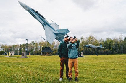 Gay Selfie in front of the Military Jets Memorial CFB Cold Lake | Road Trip Edmonton Northern Alberta © Coupleofmen.com