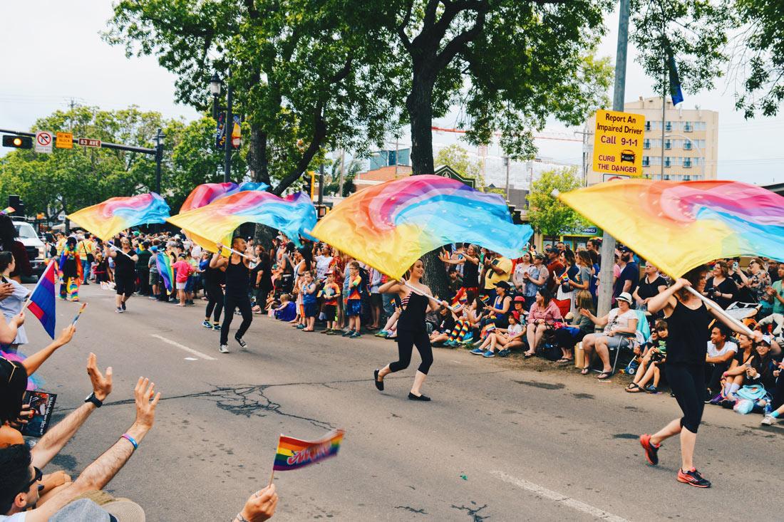 Colorful live performances with rainbow flags | Gay Edmonton Pride Festival © Coupleofmen.com