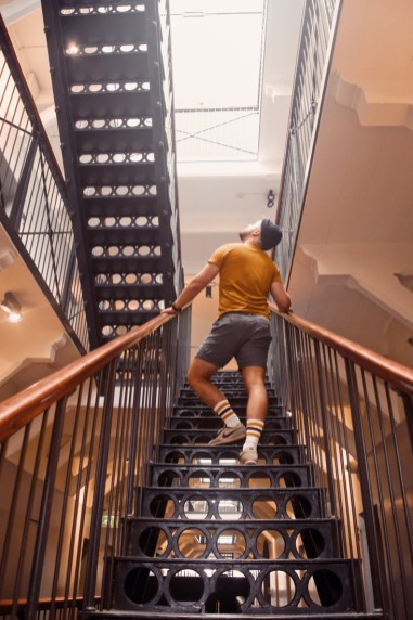 Curious Karl exploring the main building going upstairs over the historical and preserved staircase | Katajanokka Hotel Helsinki Gay-friendly Review © Coupleofmen.com