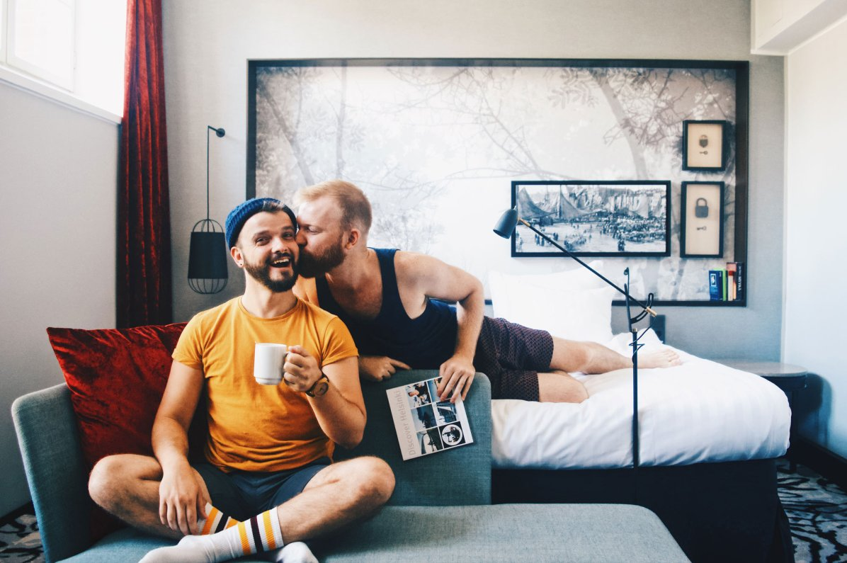 A gay kiss at gay-friendly Katajanokka Prison Hotel © Coupleofmen.com