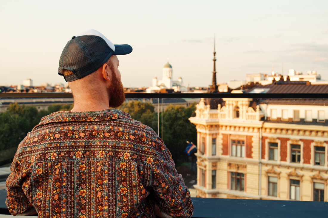 Daan enjoying the view over Helsinki and Helsinki Cathedral from the Sky Lofts Bar | Klaus K Hotel Helsinki Gay-friendly Tom of Finland Package © Coupleofmen.com