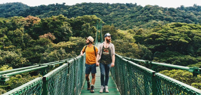 Stunning view over the treetops of the world-famous cloud forest in Monteverde | Exploring Gay-friendly Costa Rica hand-in-hand together © Coupleofmen.com