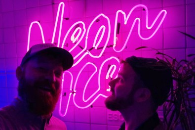 Gay Selfie in front of the Neon Ice sign, our favorite gay bar in San José | Gay-friendly Costa Rica © Coupleofmen.com