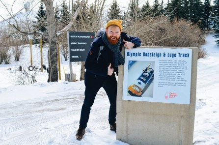 Daan before our ride at the Olympic Bobsleigh & Luge Track | Winter Road Trip Alberta Highlights Canadian Rocky Mountains © Coupleofmen.com
