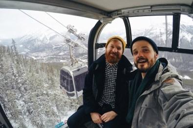Karl & Daan inside a Banff Gondola Cabin | Winter Road Trip Alberta Highlights Canadian Rocky Mountains © Coupleofmen.com