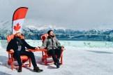 Enjoying the sun hand-in-hand on the observation deck of Banff Gondola   Winter Road Trip Alberta Highlights Canadian Rocky Mountains © Coupleofmen.com
