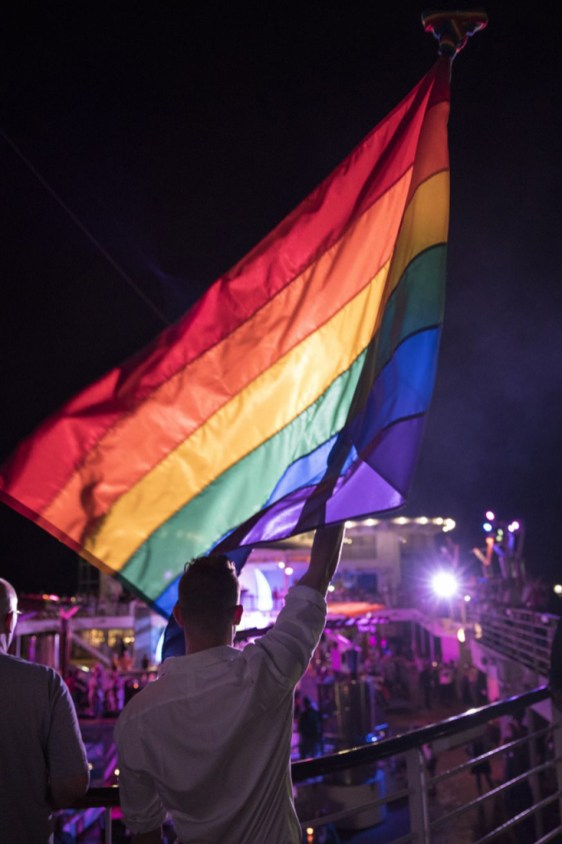 Gay Travel Christmas Presents Raising the Rainbow Flag at Celebrity Cruises' Pride at Sea Event © Celebrity Cruises