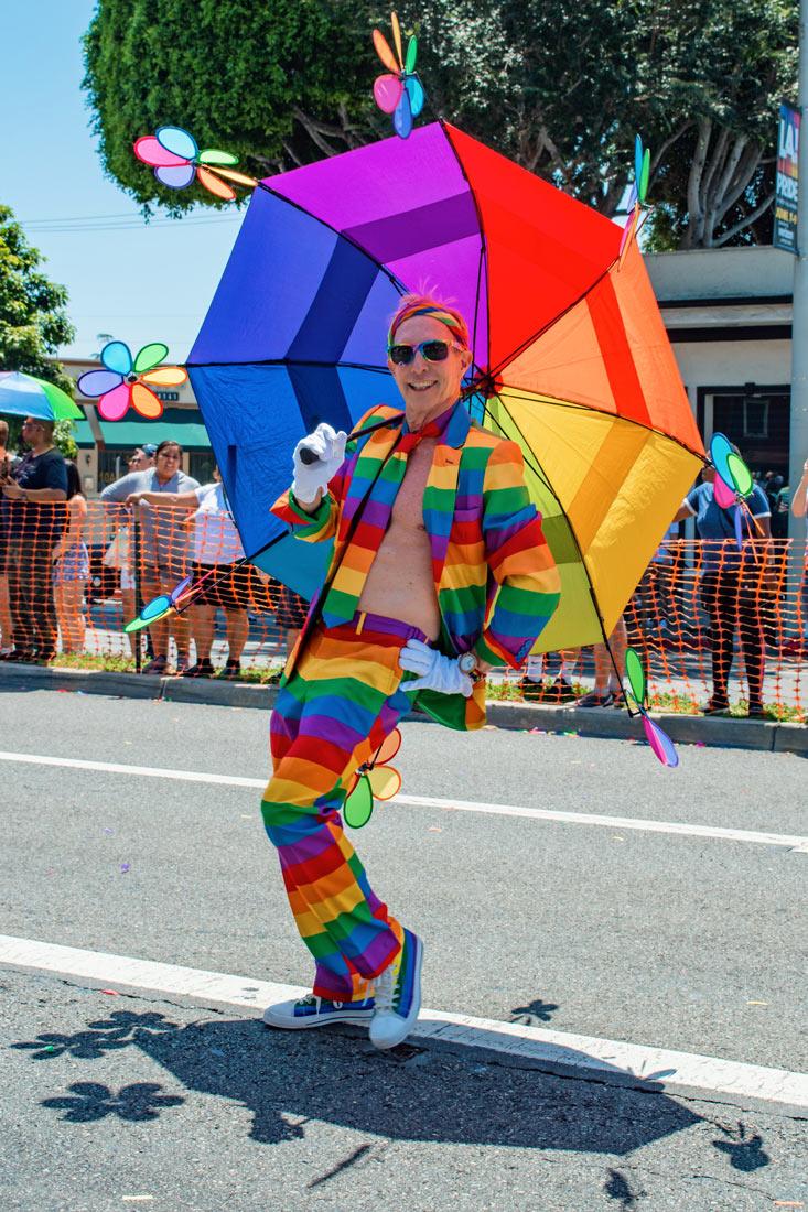 Isn't this rainbow man adorable? We love his rainbow umbrella the most! ©Coupleofmen.com