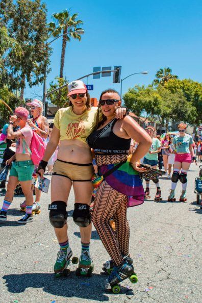 It doesn't get more rainbow California, doesn't it? LA Pride on roller skates posing in front of a palm tree. Love! © Coupleofmen.com