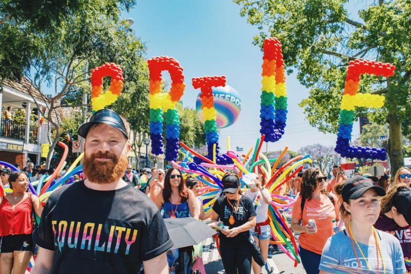 And look at this handsome ginger bearded man in front of the Pride sign (this caption was obviously written by Karl) © Coupleofmen.com
