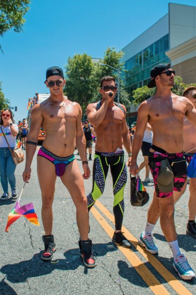 And there they are - LA Pride's Eye Candy. The sexy Queens marching half naked in tight leggings © Coupleofmen.com