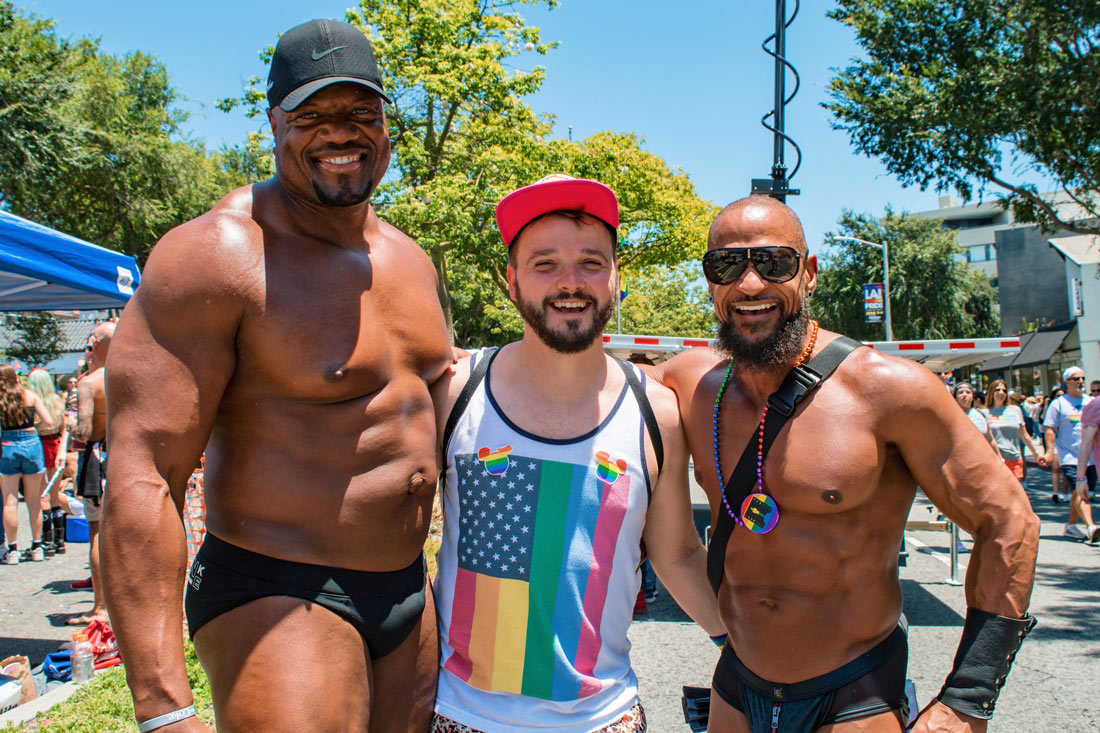 Two half naked black muscle guys arm-in-arm with Karl. Wait - Is Karl just so small or the other two guys just super tall and big? Sandwich muscle fun with © Coupleofmen.com