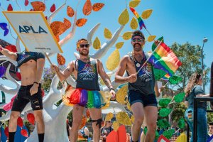 Handsome men in shorts, Tutu and with rainbow flags on a float at LA Pride 2019 © Coupleofmen.com