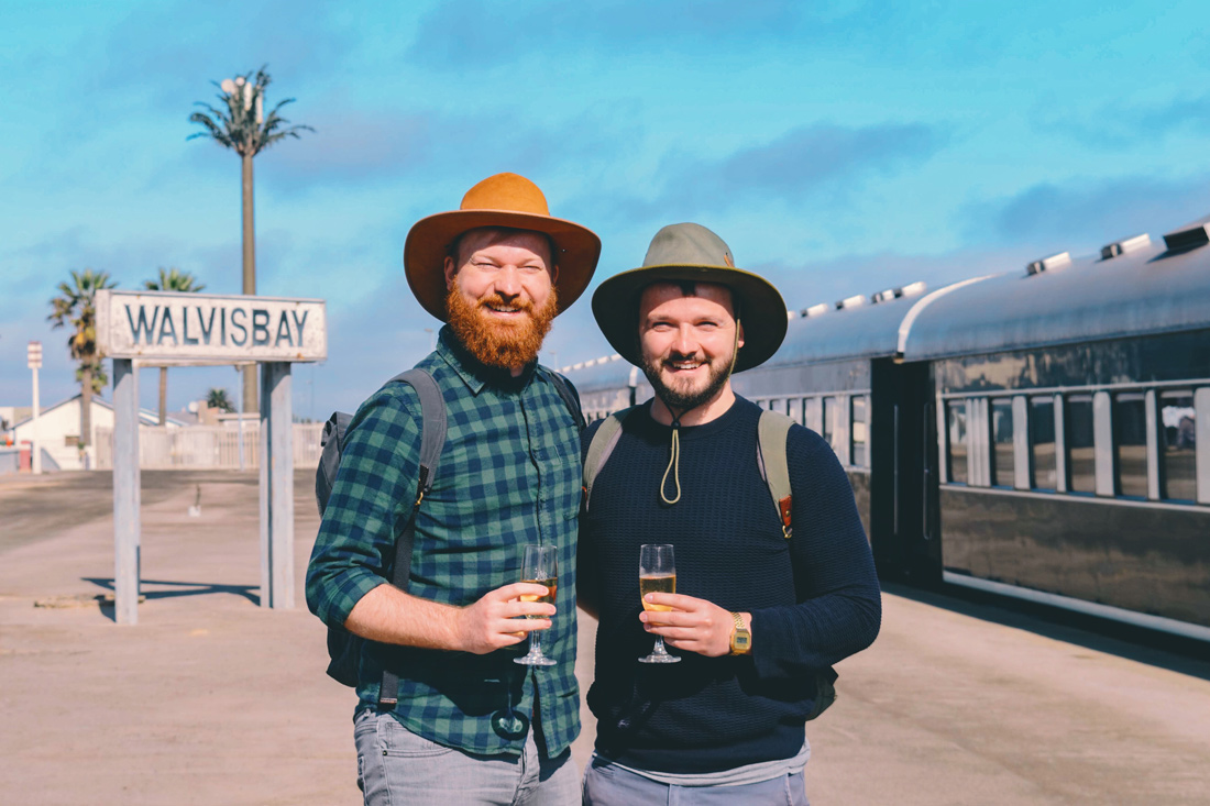 Zugreise Afrika Welcome onboard the Rovos Rail train at the Walvis Bay Station in Namibia © Coupleofmen.com