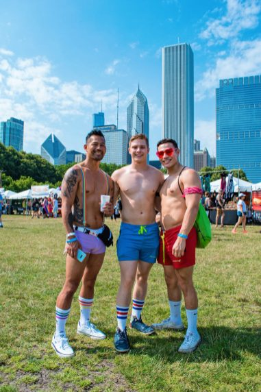 Chicago Gay City Tipps Half naked men getting ready for the Pride Park Festival on Saturday before Chicago Gay Pride Parade 2019 © Coupleofmen.com