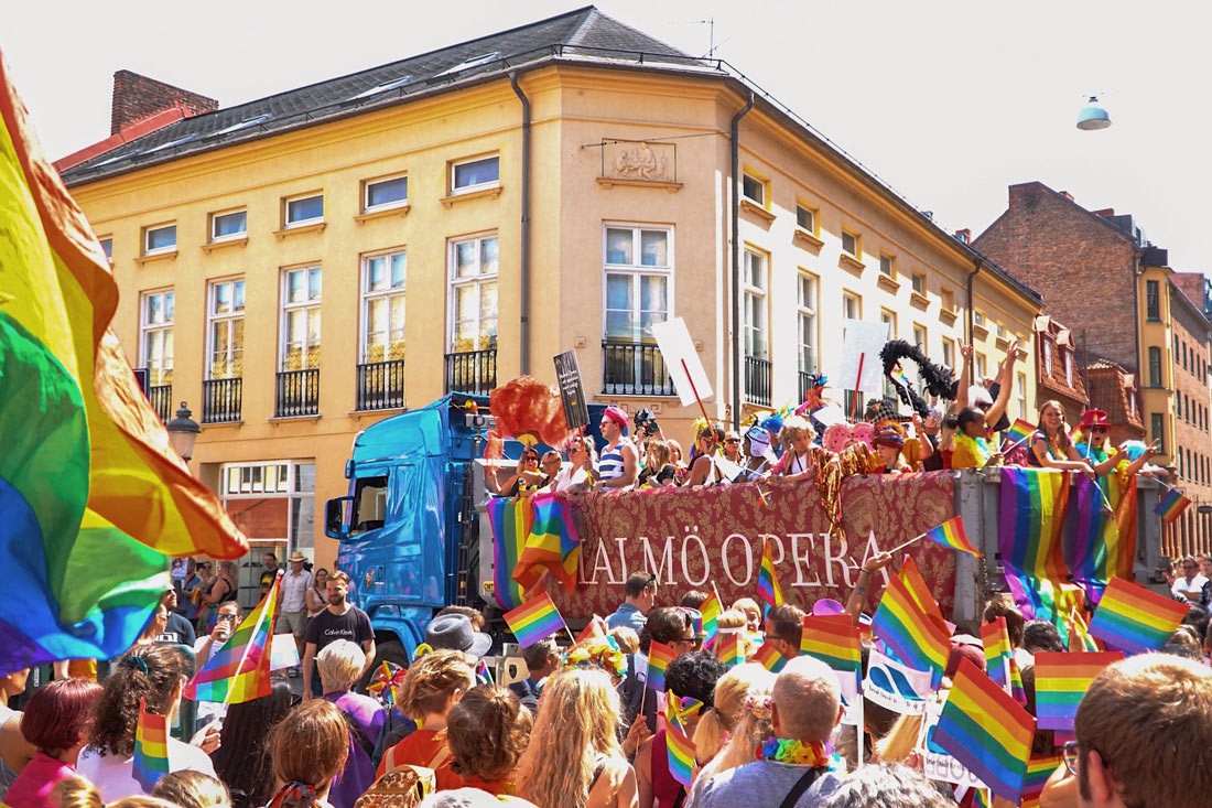 Gay Pride Malmö 2019 Malmö Pride Float of Malmö Opera surrounded by rainbow flags © Coupleofmen.com