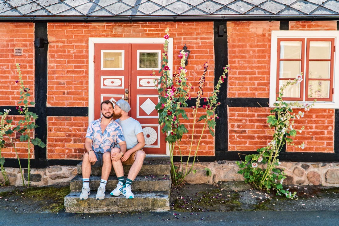 Gay Summer Road Trip Skåne Time for a gay kiss in Kivik with a gorgeous Swedish house © Coupleofmen.com