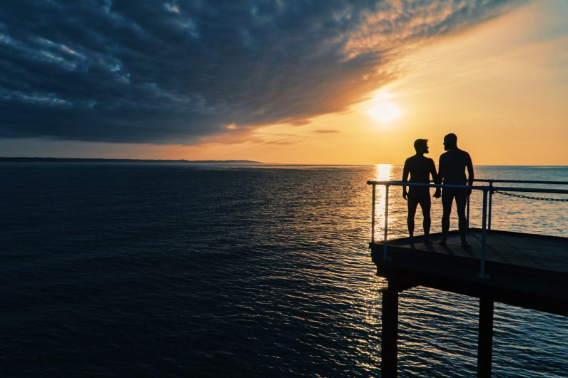 Gay Summer Road Trip Skåne Sunset overlooking Denmark from the sauna in Helsingborg © Coupleofmen.com