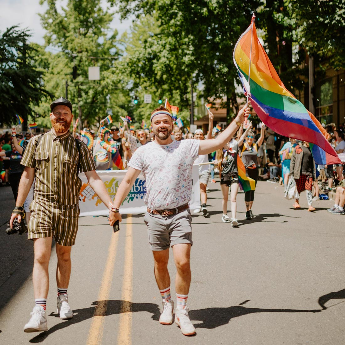 Portland-Pride-Gay-LGBTQ-Celebration-Oregon-Couple-of-Men-hand-in-hand-1