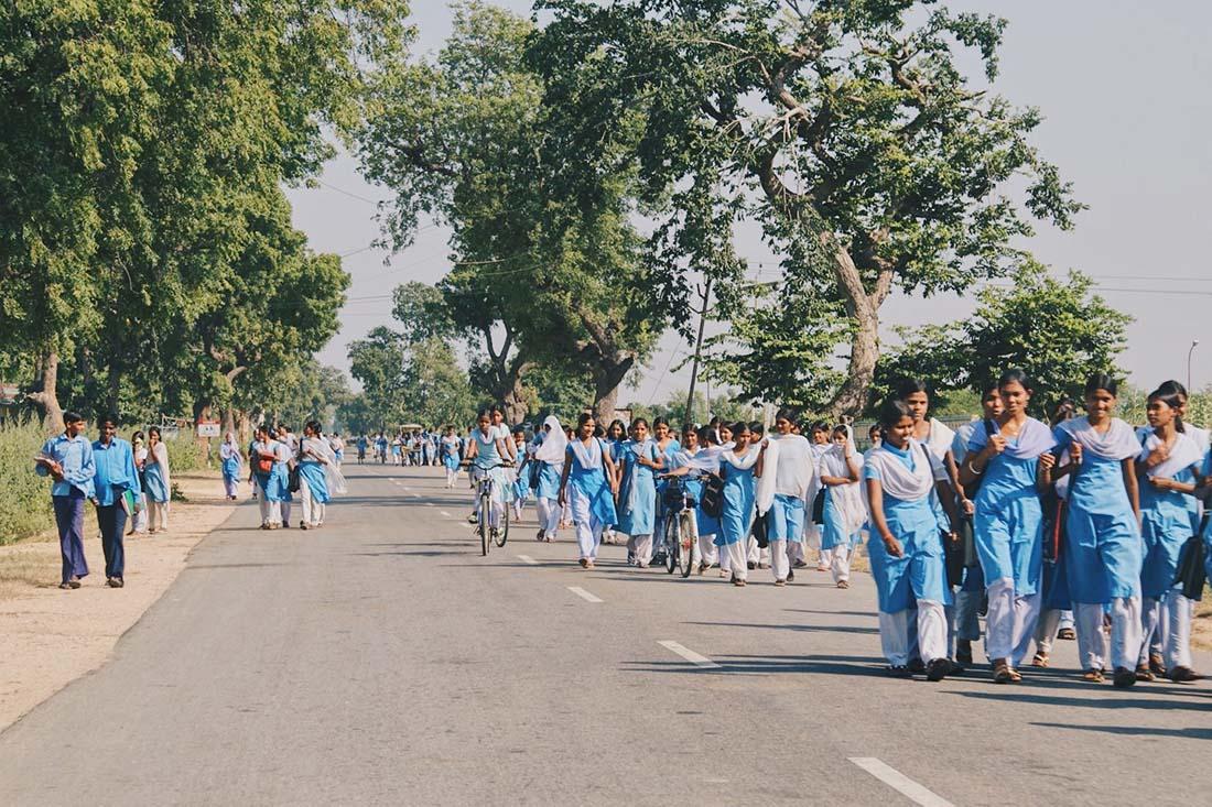 School was over - pupils in uniform on the way to Khajuraho © Coupleofmen.com