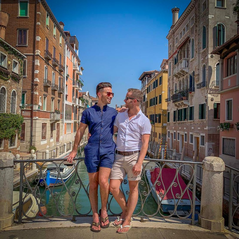 A lovely gay couple traveling around the world