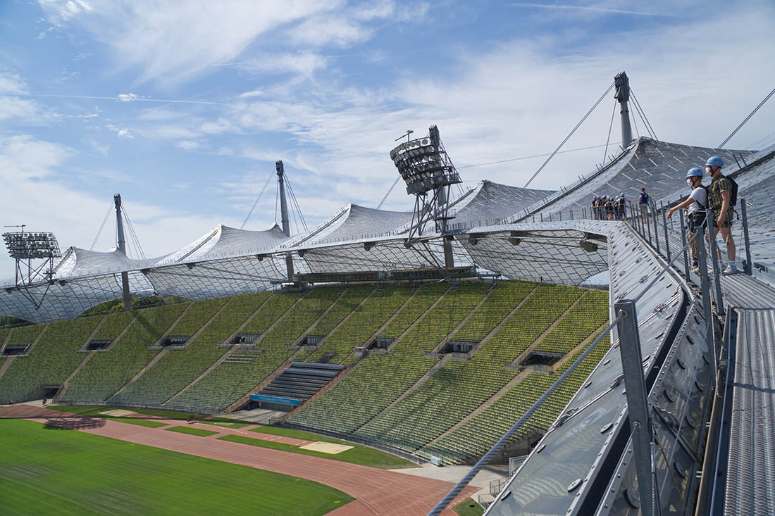 Munich Gay City Trip Exciting tour over the Olympic Stadium rooftop with a view of Munich and the Alps in the background © Coupleofmen.com
