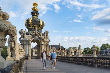 Hand-in-hand walking around the popular Zwinger in Dresden © Coupleofmen.com