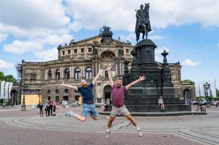 Trying our fun jumping selfies in front of the Semper Opera, Dresden-Altstadt © Coupleofmen.com