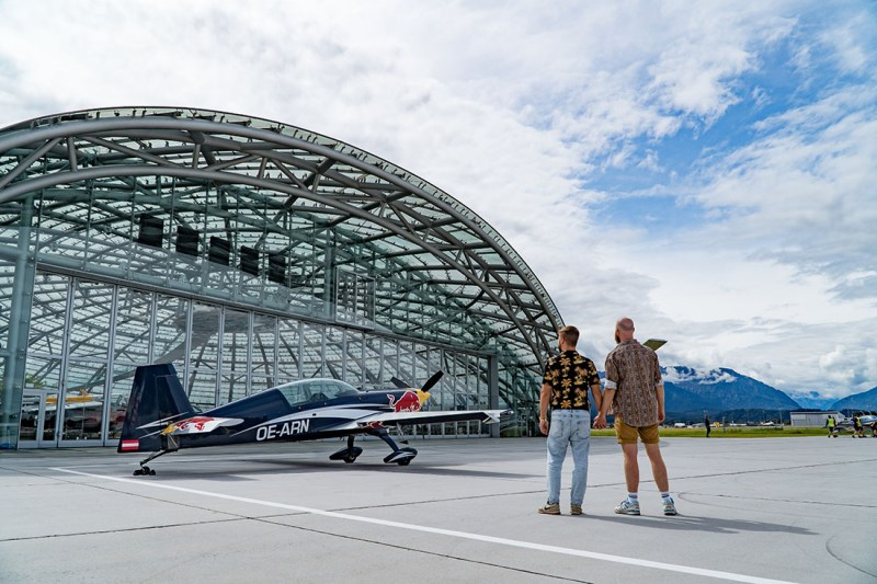 Hand-in-Hand in front of Hangar 7 to explore more of Salzburg's modern side © Coupleofmen.com