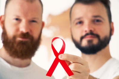 World Aids Day - A Kiss in support of people with HIV © Coupleofmen.com