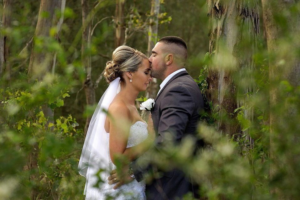 Newlywed couple kissing - tips for making your marriage work.