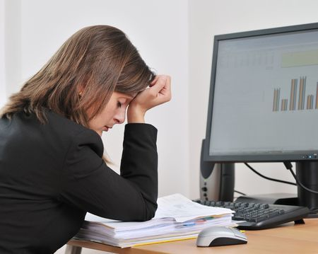 5798383 - tired young woman survivinginfidelity sitting at computer on workplace