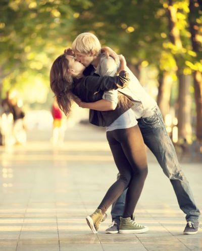 14727960 - young couple kissing on the street
