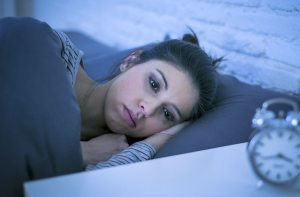 Image of a woman unable to sleep after a breakup. CBT & Relationship Counseling in Cincinnati, OH 45226 helps!