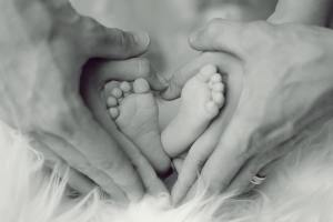 Photo of a new baby foot & parents hands l Marriage counseling for new parents l Cincinnati, OH 45226