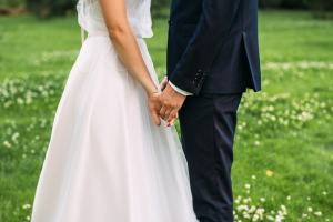 Photo of newlywed couple holding hands | Counseling Before Marriage | Couples Counseling | Cincinnati, OH 45226