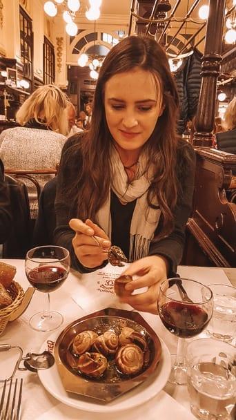 woman-eating-escargo-snails-dinner-chartier-restaurant-paris