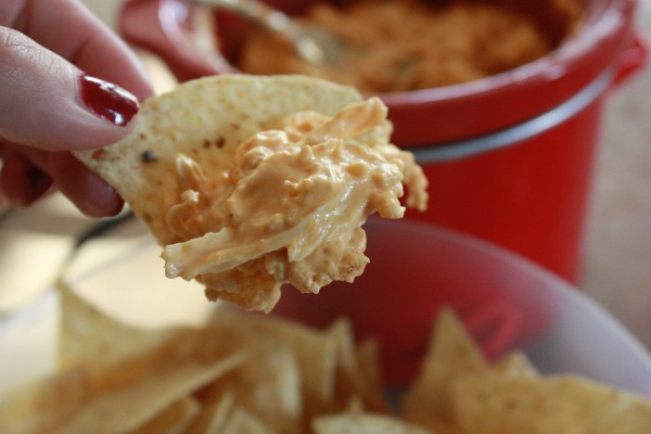 This buffalo chicken dip crock pot recipe is one of our all-time favorite appetizer recipes. This is an easy appetizer that can be thrown together in no time at all to feed a crowd on a budget. If you're on the hunt for chicken appetizers, crockpot ones especially.. this is it!