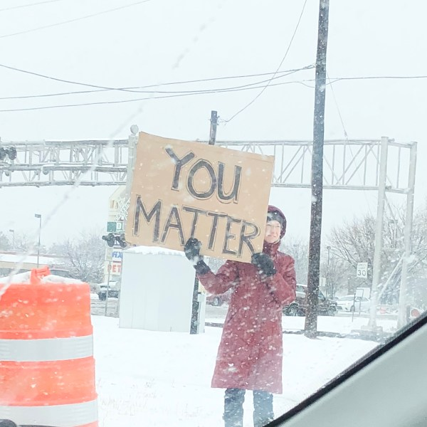 Women holding a you matter sign in Boise Idaho taken by courageusly.u