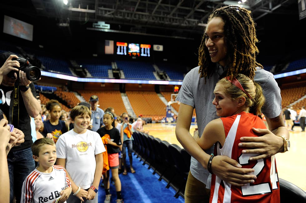 Griner happily posed for photos with Krapf as she tried to hold back her tears of joy.