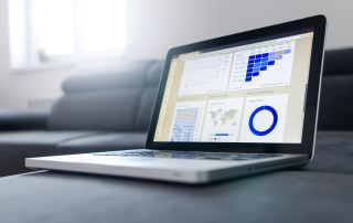 a laptop with data analysis dashboard